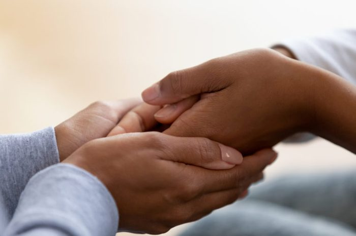act of kindness holding hands