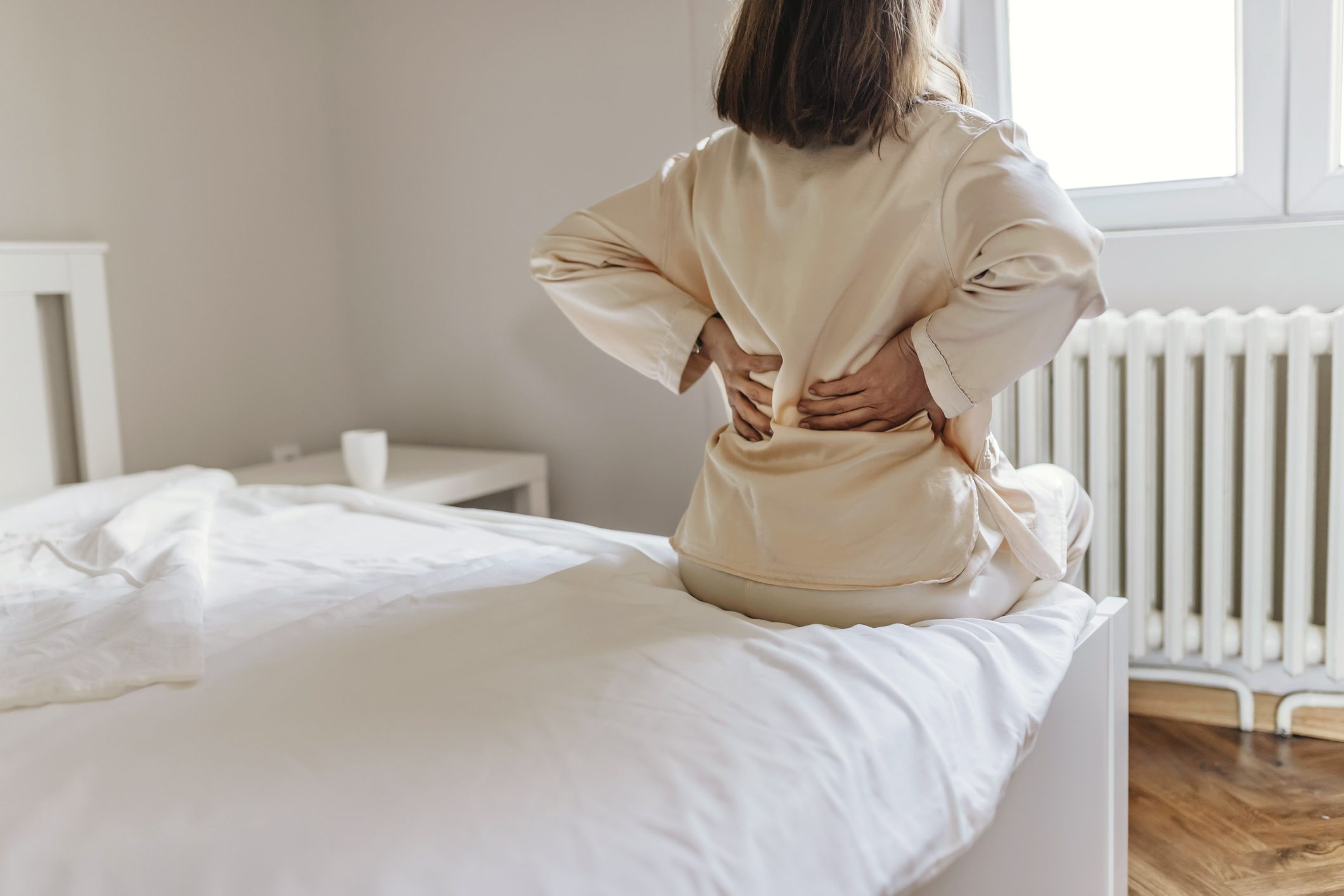 woman sick with aches and pains or myalgia