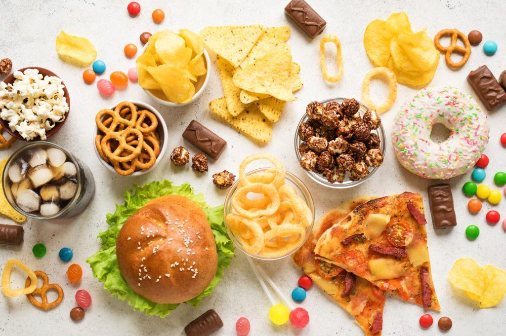 assortment of unhealthy snacks and foods overhead studio