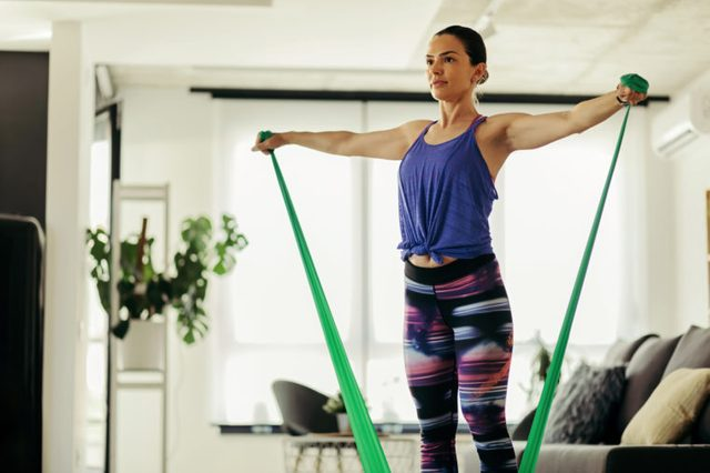 woman working out exercising in her living room