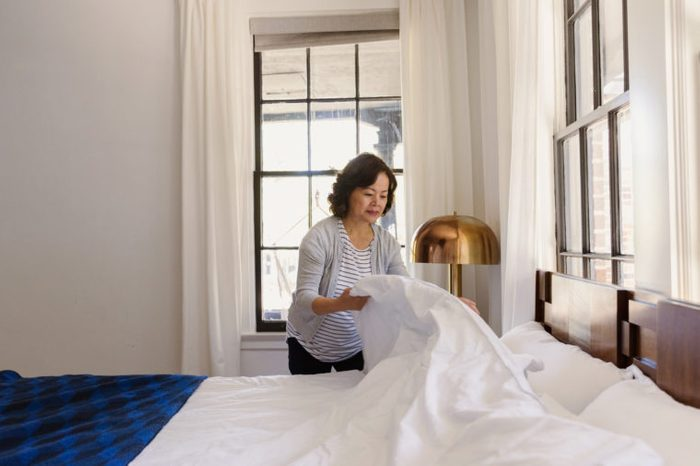 woman making her bed