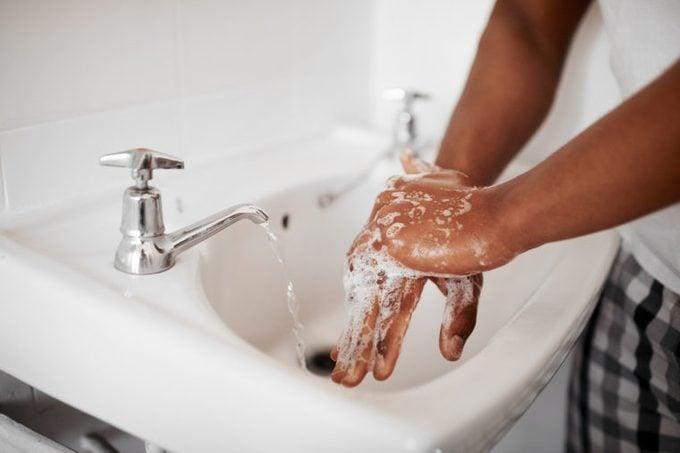 washing hands in bathroom sink