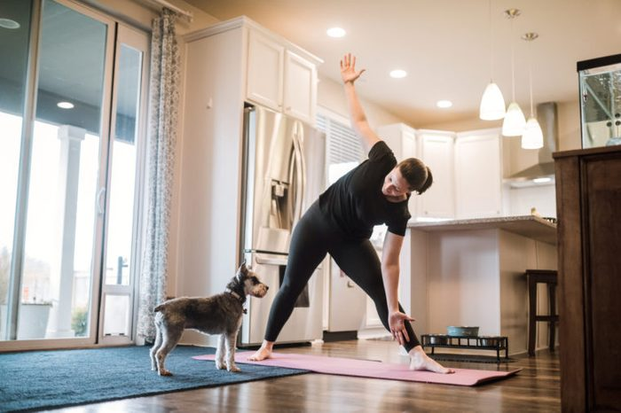 woman doing yoga in her house
