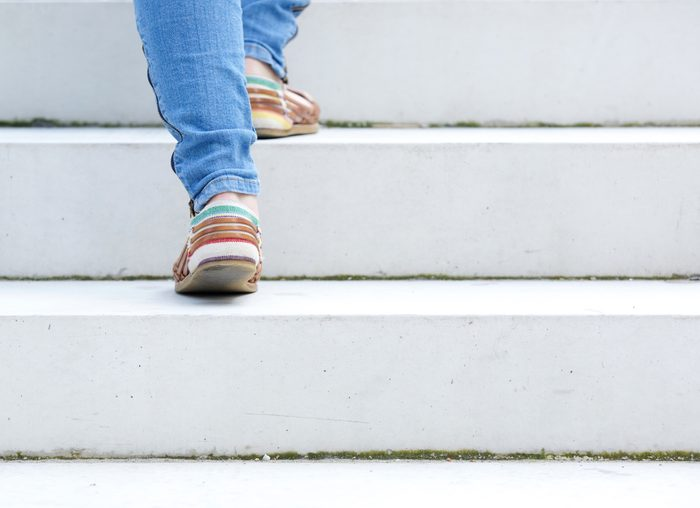close up on woman walking up stairs