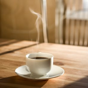 hot coffee in mug on kitchen table