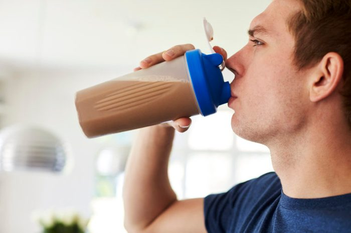 man drinking a protein drink