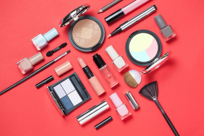 makeup cosmetics on red background