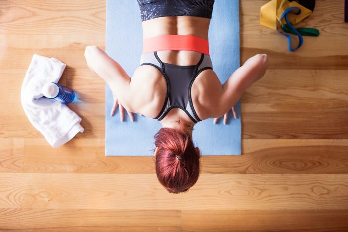 young woman exercising at home