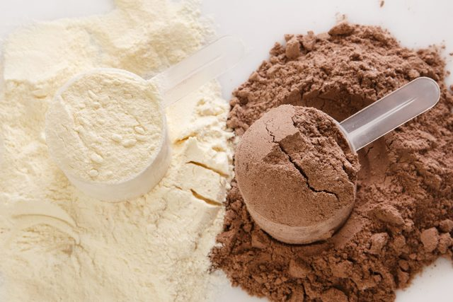 chocolate and vanilla protein powder in scoops