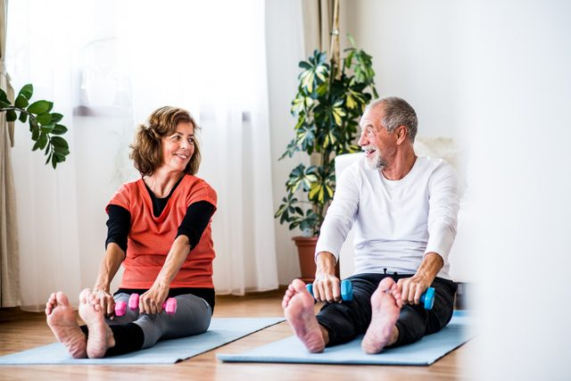 senior couple working out at home