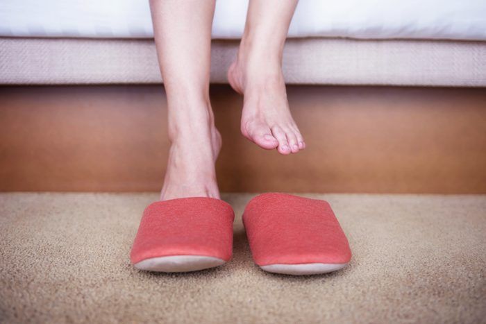 close up of woman putting on slippers