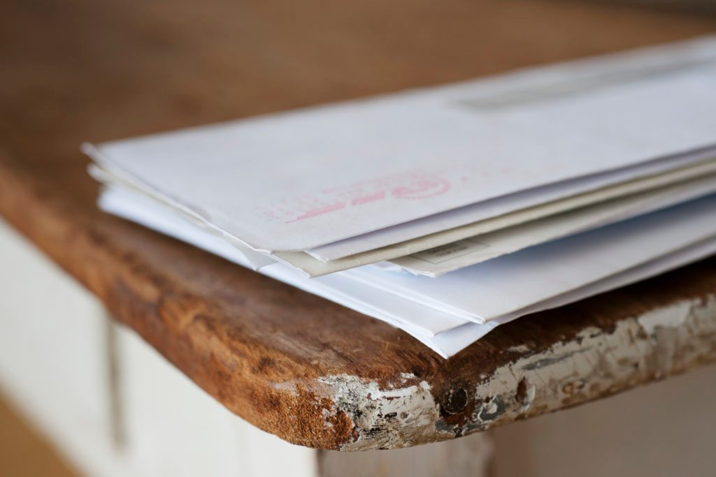 stack of mail on the table