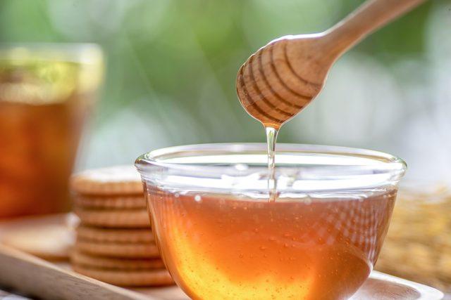 honey dipper in honey