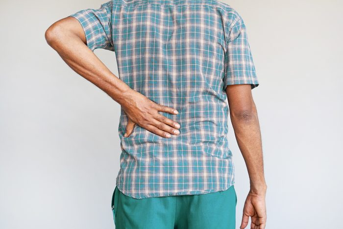 cropped shot of man with arthritis in lower back