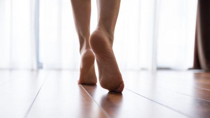 close up of woman's feet walking in home