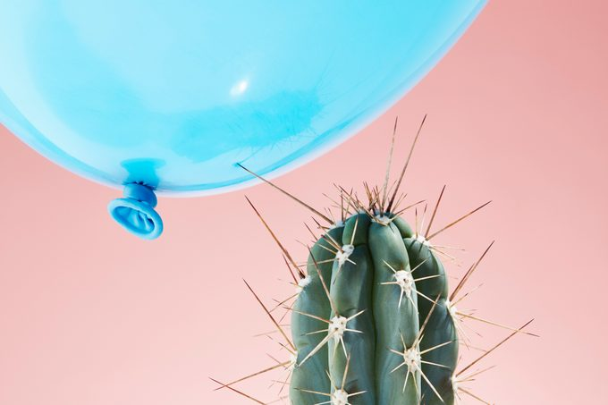 stress concept with cactus and balloon