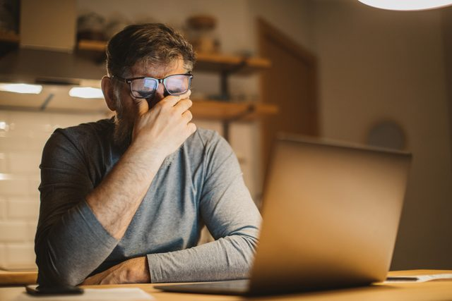 man frustrated with work at home during isolation quarantine