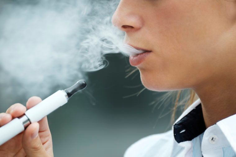 close up of woman vaping