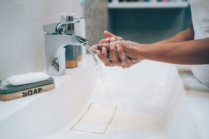 cropped close up shot of woman washing her hands