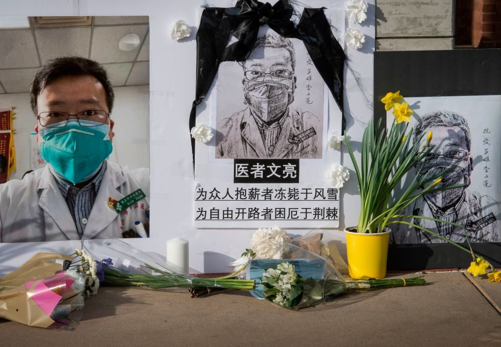 Chinese students and their supporters hold a memorial for Dr Li Wenliang, who was the whistleblower of the Coronavirus, Covid-19, that originated in Wuhan, China and caused the doctors death in that city, outside the UCLA campus in Westwood, California, on February 15, 2020. - The death toll from the new coronavirus outbreak surpassed 1,600 in China on Sunday, with the first fatality reported outside Asia fuelling global concerns. (Photo by Mark RALSTON / AFP) (Photo by MARK RALSTON/AFP via Getty Images)