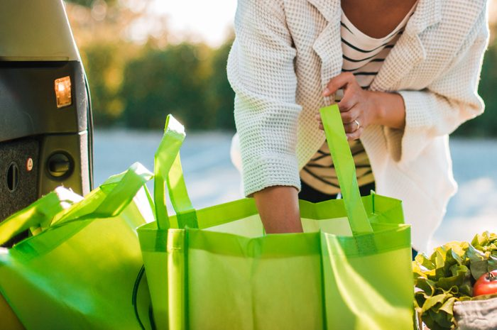 Muslim girl picking up groceries