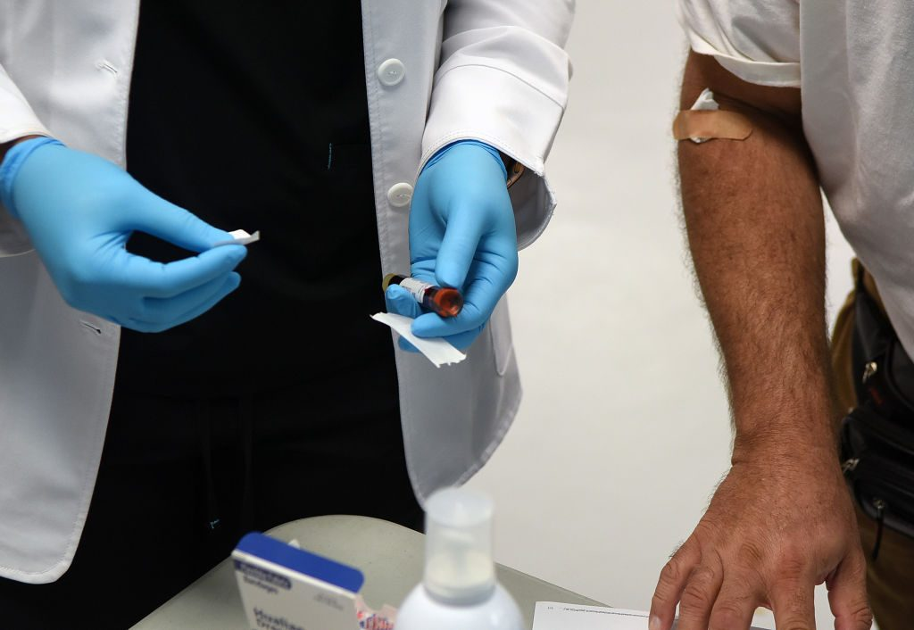 close up of health care worker taking blood sample for coronavirus antibody testing