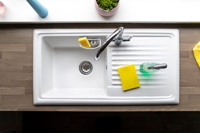 directly above shot of clean kitchen sink with sponges