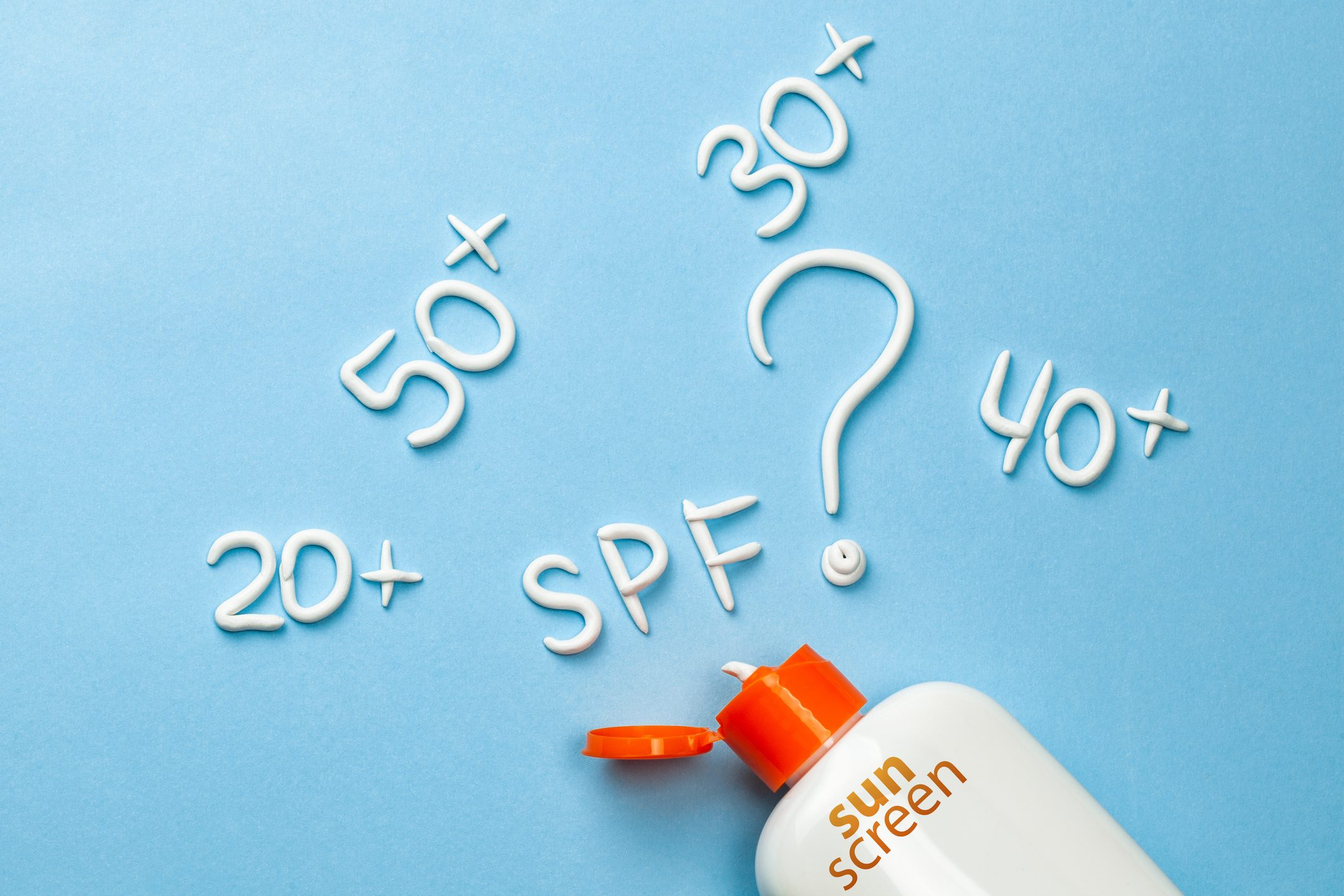 SPF sunscreen bottle concept on blue background