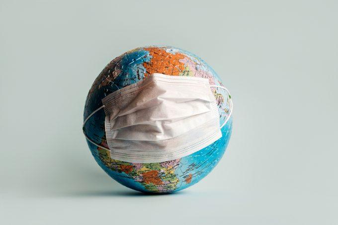 globe with mask; coronavirus pandemic concept