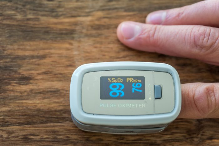 close up of finger in pulse oximeter