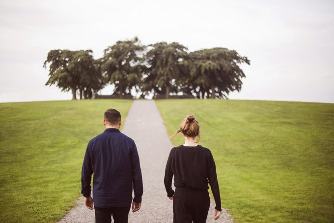 rear view of couple walking outside