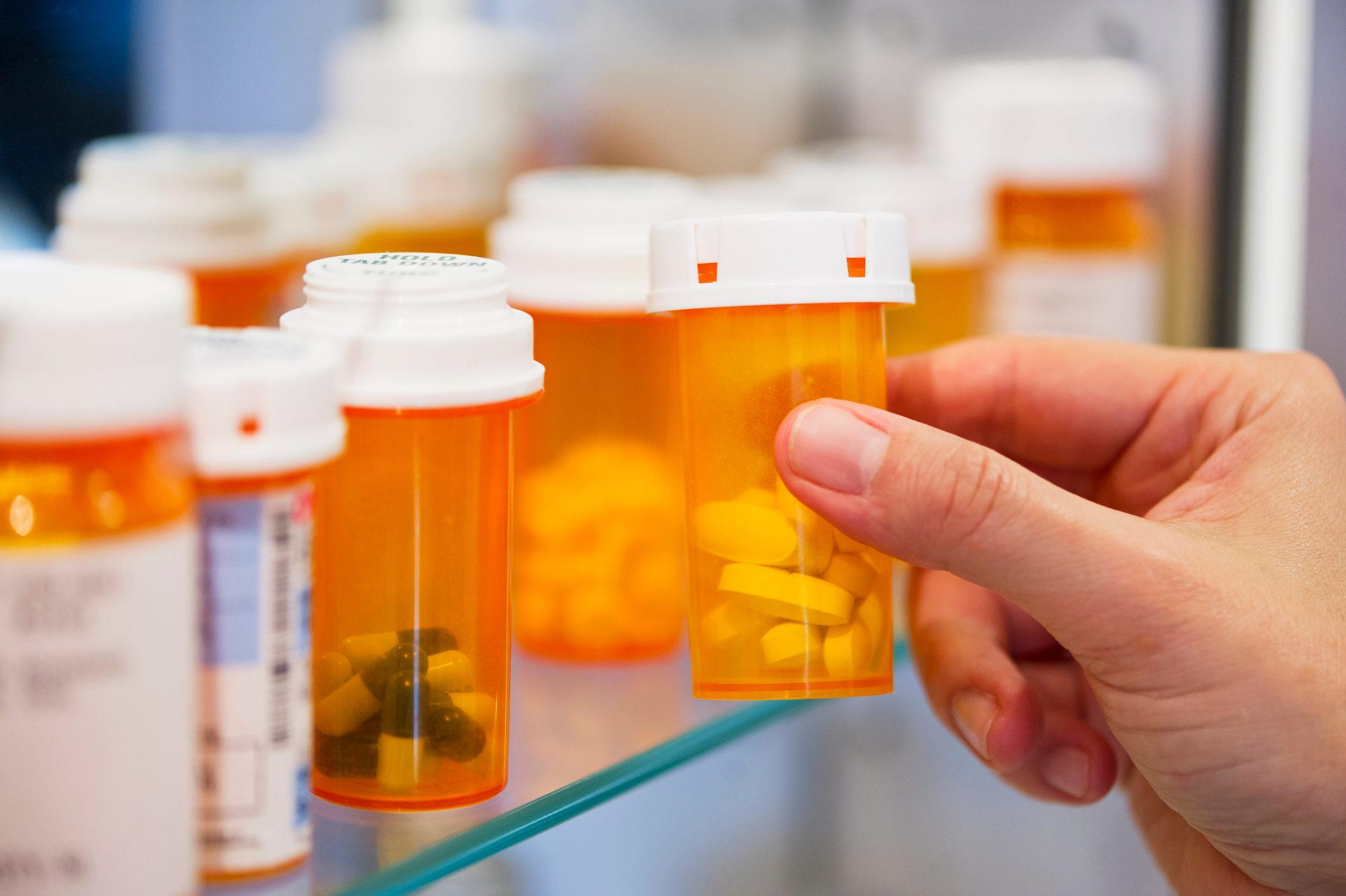 prescription pill bottles in medicine cabinet