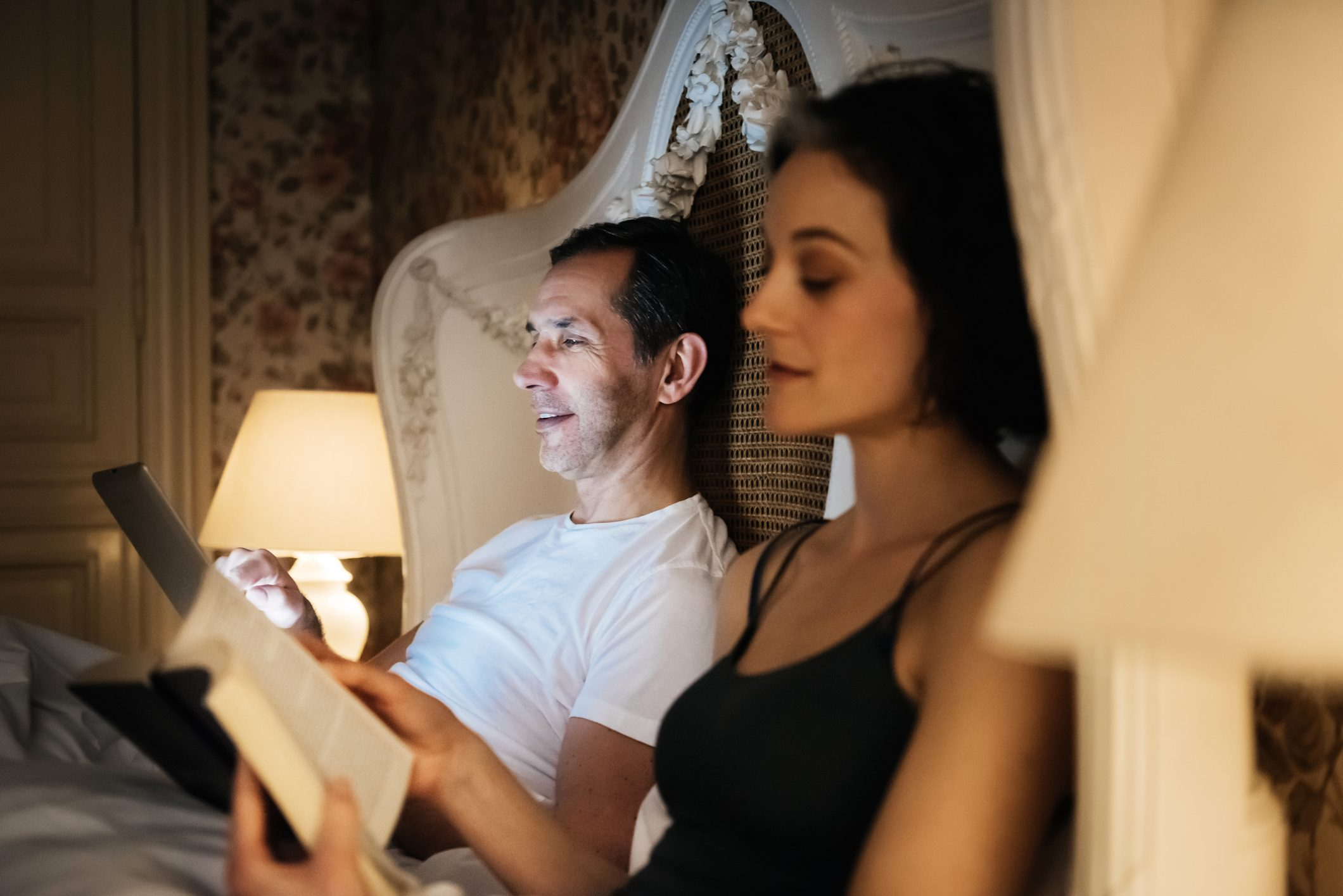 couple reading in bed before going to sleep