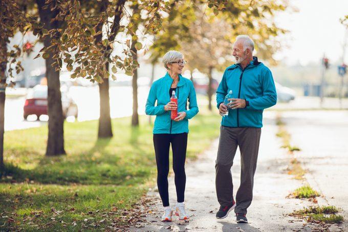 senior couple walking together outside