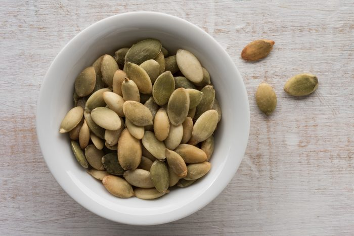 pumpkin seeds in bowl shot from above
