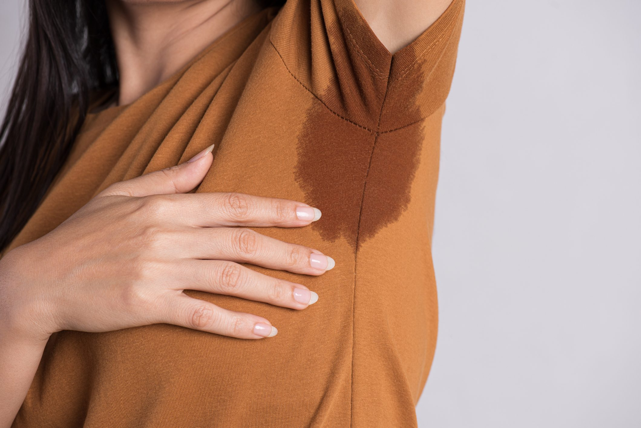 close up of woman's underarm sweat