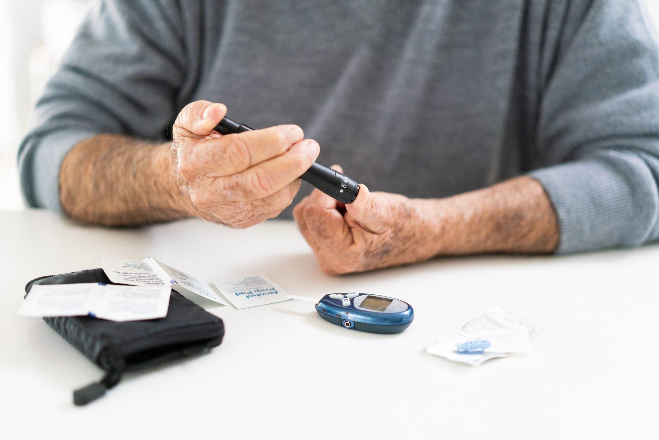 man with diabetes taking blood sugar