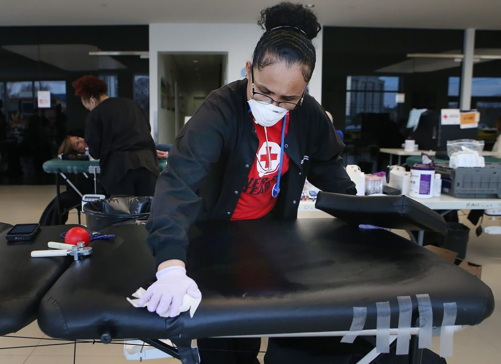 american red cross phlebotomist sanitizing medical bed