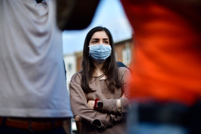 woman wearing a face mask at a protest