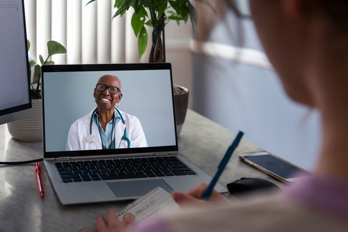 woman talking to doctor virtually on computer