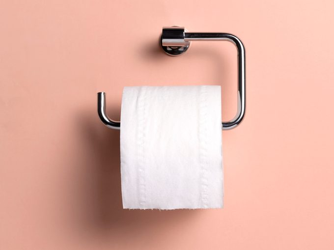 toilet paper roll on salmon color background