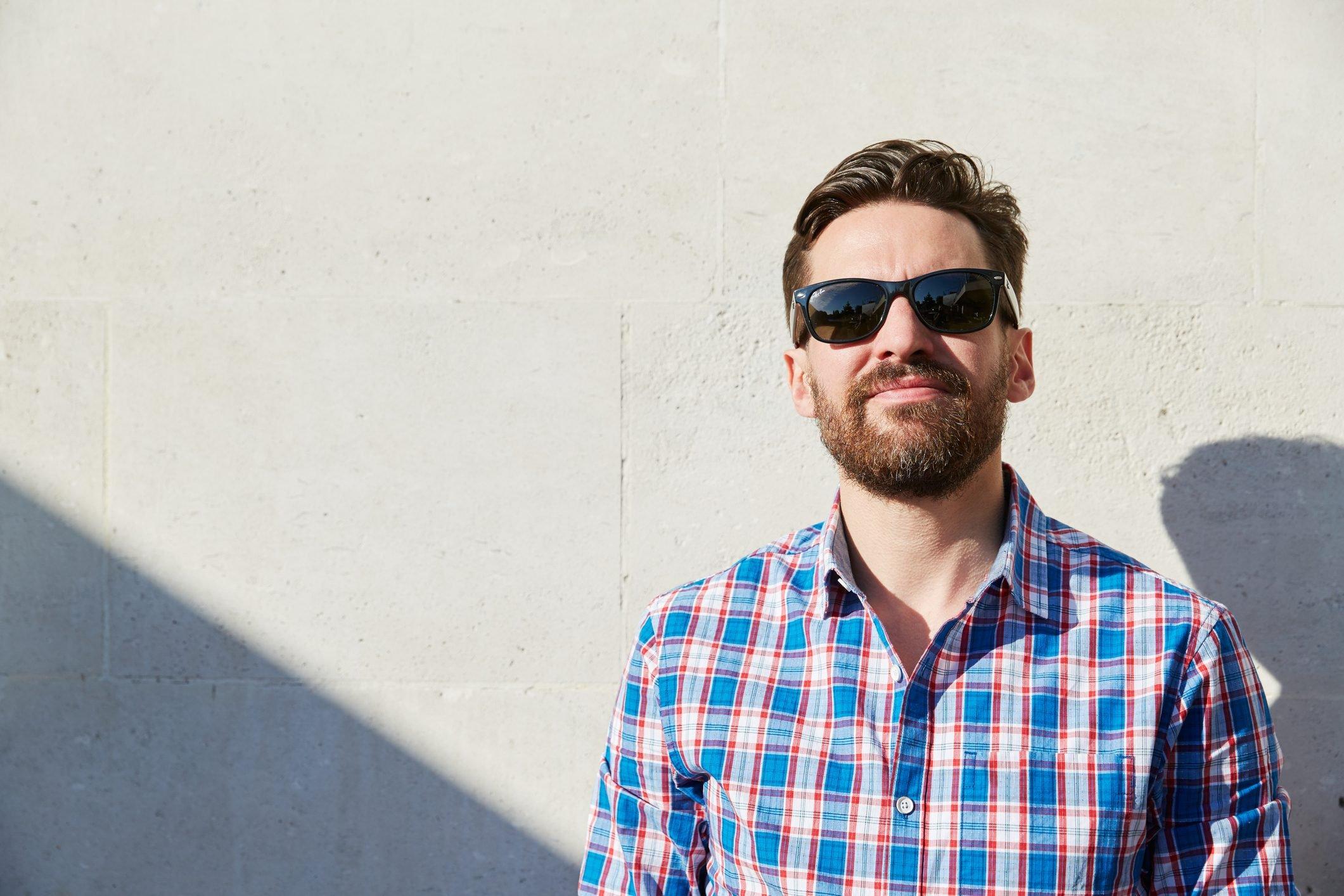 man wearing sunglasses in the sunshine