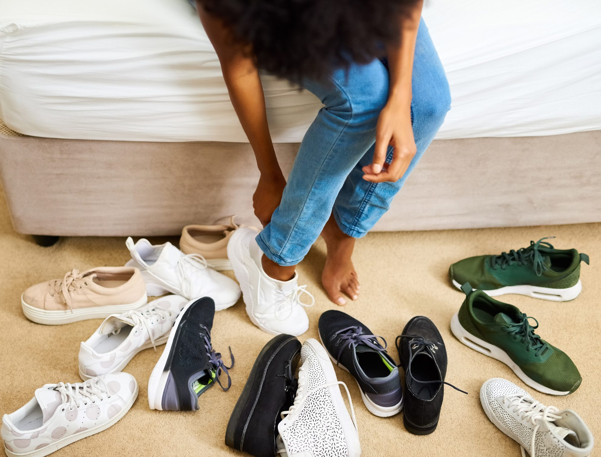 woman trying on sneakers