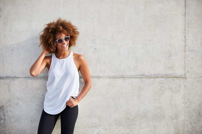 happy smiling woman in tank top