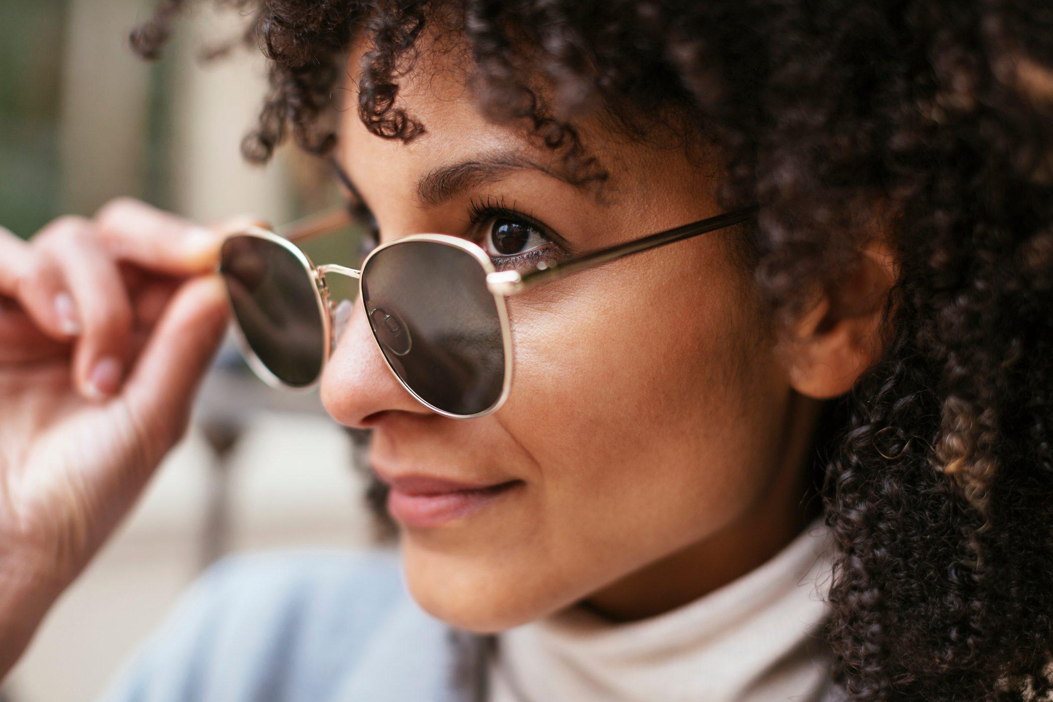 close up of woman wearing sunglasses