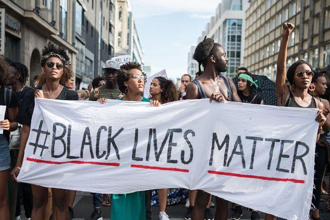 protestors holding black lives matter sign