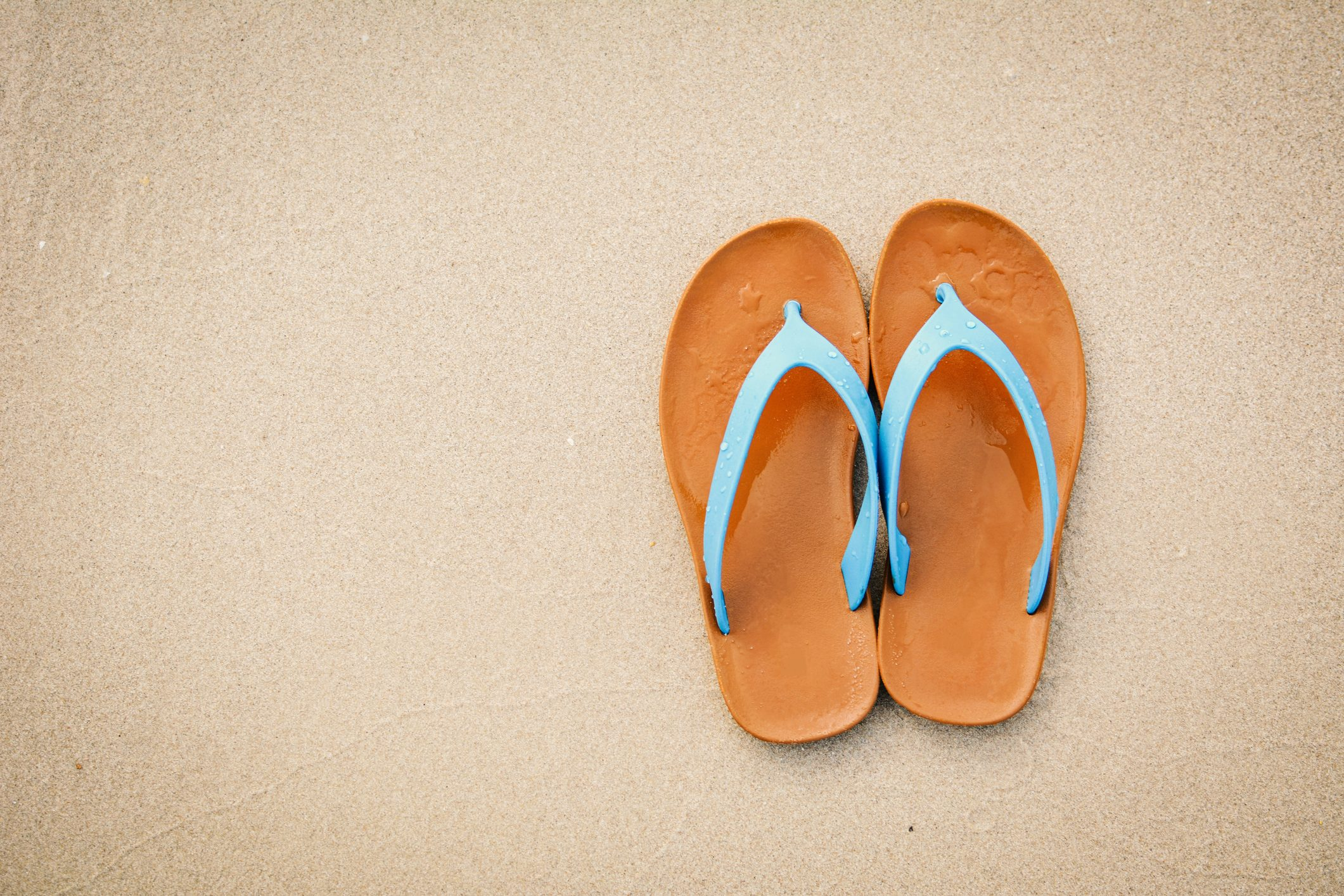 flip flops shot from above on sand beach