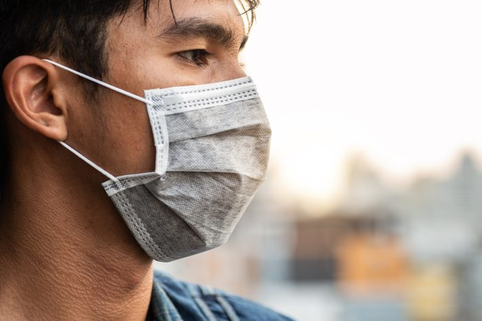close up profile of man wearing a face mask