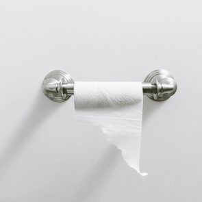 toilet paper holder on gray wall