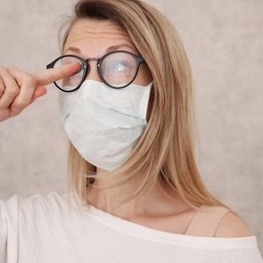 medical face mask and fogged glasses